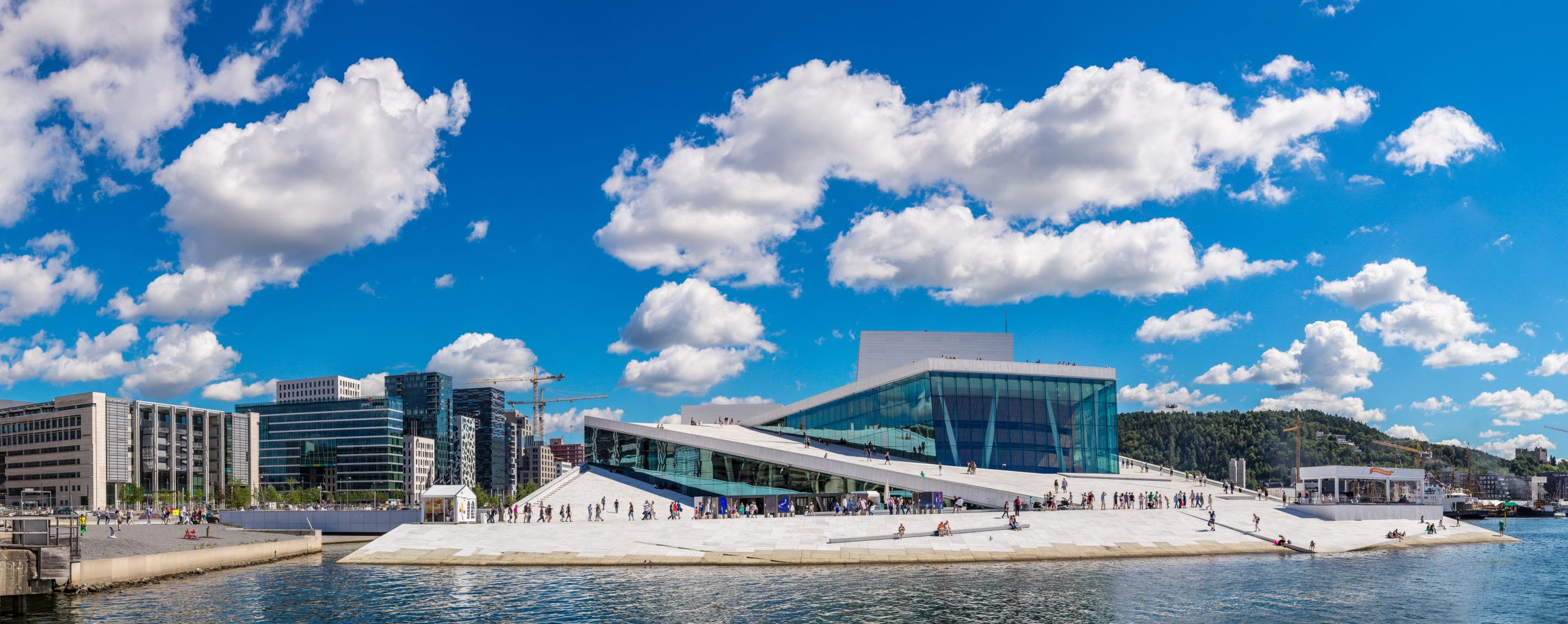OSLO, NORWAY - JULY 29: The Oslo Opera House is the home of The Norwegian National Opera and Ballet, and the national opera theatre in Norway in Oslo, Norway on July 29, 2014