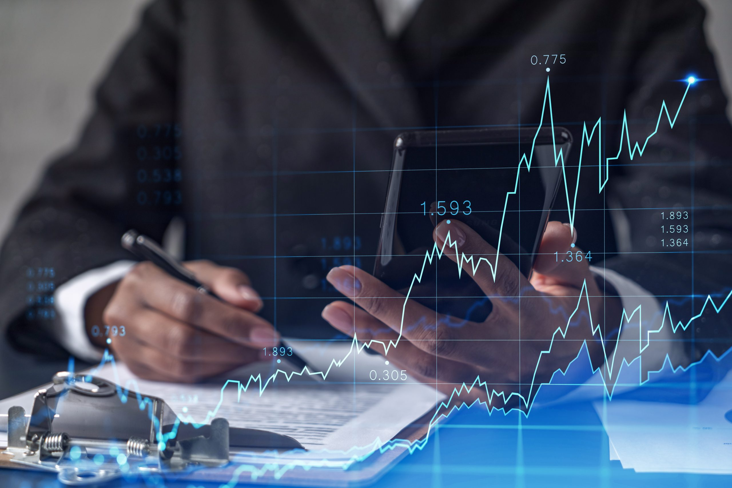 African American businesswoman in formal wear is signing the contract to invest money in stock market. Internet trading and wealth management. Checking the details of transaction at smart phone. Forex